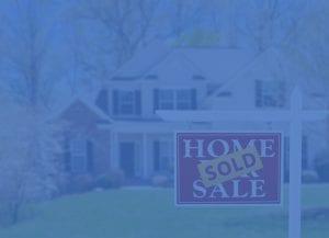 blue filter over home sold sign